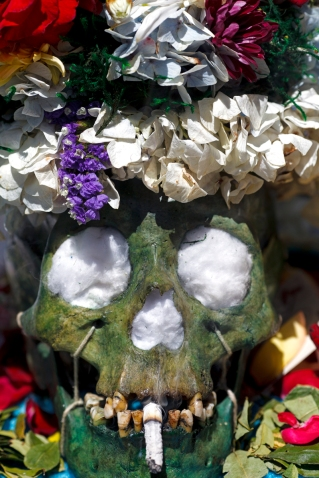 La Paz, Bolivia, tinted green skull at the annual skull festival in the Cemetery Genera WEBl